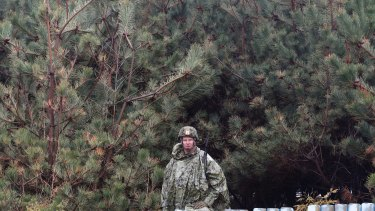 An American soldier stands guard during the US-South Korea joint exercise in Pohang, South Korea, last Tuesday.