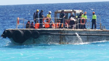 Asylum seekers could be split between Papua New Guinea's Manus Island and Malaysia.