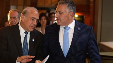 OECD secretary-general Angel Gurria with Treasurer Joe Hockey in February. Mr Gurria said a carbon tax or emissions trading scheme was the most efficient way to cut greenhouse gases.
