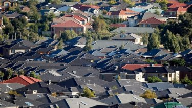 Investors are holding back in the housing market as banks tighten credit.