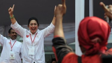 Siti Hediati Harijadi, known as Titiek, daughter of late Indonesian dictator Suharto and ex-wife of presidential candidate Prabowo Subianto greets the crowd during a rally for Subianto in Jakarta in June.