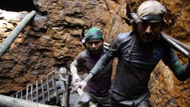 """""""I don't like this work, but I have to do it"""": Gayasuddin, at rear, has been a miner since he was 12."""