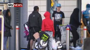 Looters are seen lining up at JD Sport.