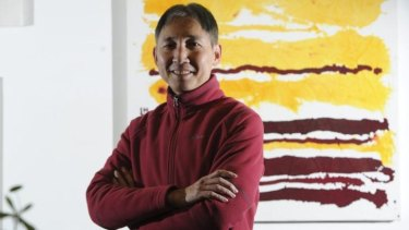 Hou Leong with his painting <i>Red and Yellow Horizontal Lines.</i>