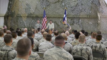 Former Texas Governor Rick Perry (centre) speaks at Camp Swift Army National Guard Training facility in 2014. Up to 1000 Texas National Guard troops were deployed to the Mexican border last year.