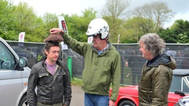 Richard Hammond, Jeremy Clarkson and James May mess around on set.