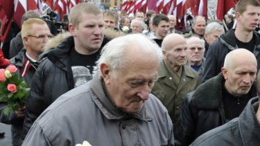Latvians march to honour soldiers of the SS unit known as the Latvian Legion.