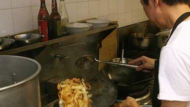 John Chan from Singapura Eating House prepares Char Kway Teow.