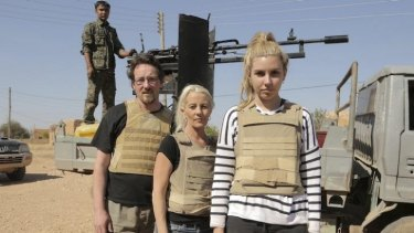 War zone ... Kim Vuga, centre, with Andrew Jackson and Nicole after their close call with Islamic State.