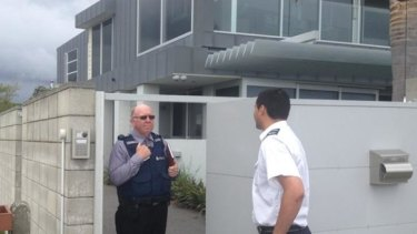 New Zealand police at the home of AC/DC drummer Phil Rudd.