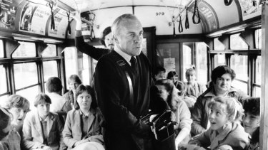 A Melbourne tram, circa 1985: Conductor Jimmy Fitzgerald collects fares.