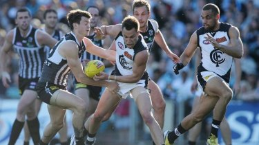 Port Adelaide will be wearing its black and white jumper against Richmond.