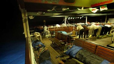 Activists sleep and pray on the Turkish passenger ship MV Marmara carrying 600 activists, part of the freedom flotilla headed to Gaza.