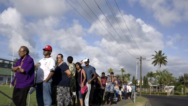 Native Fijians and ethnic Indians in a queue to vote in Fiji.