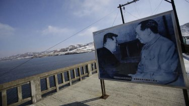 Allies … a picture of Mao Zedong and North Korea's late leader Kim Il-sung on the Hekou Bridge linking China and North Korea.