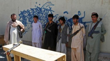 Arrested Taliban fighters are displayed to the media in Panjwai district of Kandahar province in southern Afghanistan on May 28, 2013. Suspected Taliban militants killed seven police in southern Afghanistan after persuading the officers to invite them into their checkpoint for dinner, officials said on Tuesday.