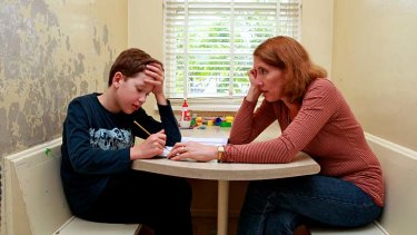 Practice makes perfect: Jane Whitelaw with her son George, 11, studying at home for the NAPLAN tests.