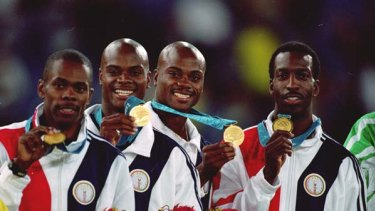 Shame ... US legend Michael Johnson, far right, handed back his 4x400m gold medal after teammates Alvin Harrison, second from left, and Calvin Harrison, third from left, received drugs bans, while Antonio Pettigrew, far left, admitted to doping.