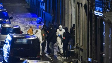 Belgian police inspect an apartment in central Verviers.