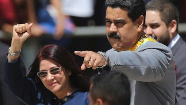Venezuelan President Nicolas Maduro, right, and first lady Cilia Flores greet supporters in February.