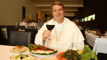 Bishop Anthony Fisher at El Phonecian Restaurant in Parramatta in 2011.