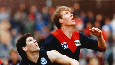 Stynes battles it out with Carlton's Steve Kernahan at Princes Park.
