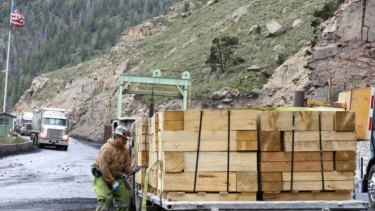 A worker unloads wood at the Sufco Coal Mine in Utah, which produces 30,000 tonnes of low-sulphur coal a day. US President Barack Obama's announcement is expected to target coal-fired power plants in a bid to reduce carbon emissions.