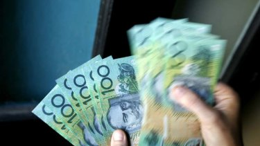Money bags ... the average Australian has access to nine $100 notes, up from eight three years ago.