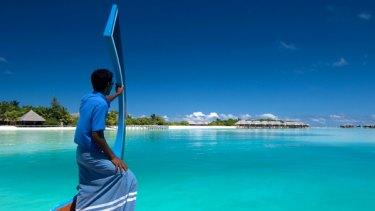 Dhoni approaches Conrad Maldives Rangali Island.