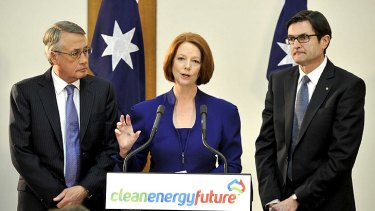 Julia Gillard delivers the carbon tax package in Canberra yesterday, flanked by Treasurer Wayne Swan (left) and Climate Change Minister Greg Combet.