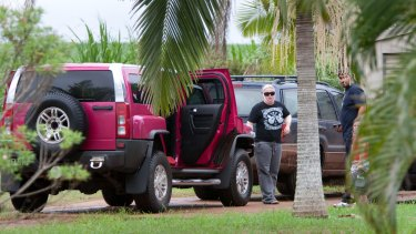 """Mehmet """"Max"""" Tosun and his wife Calie (""""Kelly"""") arrive at their Childers home in their pink Hummer."""