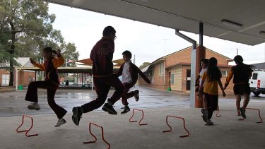 Stepping it up ...  students at Lansvale Public School  exercise in a covered area. Lansvale uses time within school hours to meet  the exercise target outlined by the Department of Education.