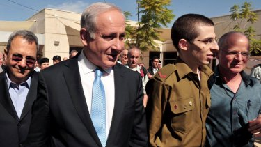 On Israeli soil .... Gilad Shalit with Israeli Prime Minister Benjamin Netanyahu, left.