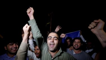 Supporters of Afghan presidential candidate Ashraf Ghani celebrate on the street after he was named president-elect in Kabul September 21, 2014.