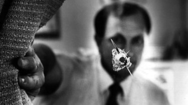Murdered: John Newman and a bullet hole in his Canley Heights office in 1993.