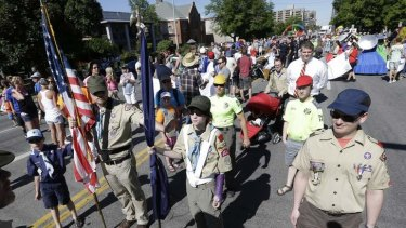 Boy Scouts are shown lining up before marching in the Utah Gay Pride Parade in Salt Lake City. Members of Scouts for Equality marched in the parade following last week's vote by Boy Scouts of America to allow openly gay youth to participate in scouting.