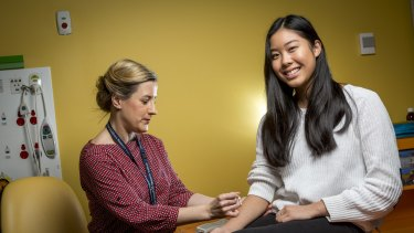 Caitlin Louey, 16, who has suffered from anaphylaxis to pecan nuts, undergoes allergy testing from research nurse Holly Shaw as a part of SchoolNuts, a Murdoch Children's Research Institute study.