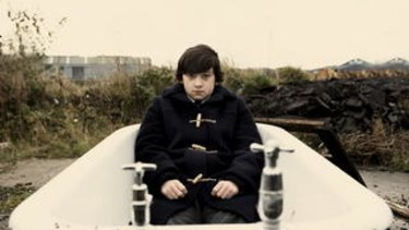 One boy in a tub: Oliver Tate (Craig Roberts) tries working his way through the woes of teenhood in the quirky British comedy <i>Submarine</i>.