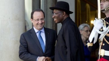 Working together: Nigeria's President Goodluck Jonathan is escorted by French President Francois Hollande as he leaves a Paris summit on the threat from Boko Haram.
