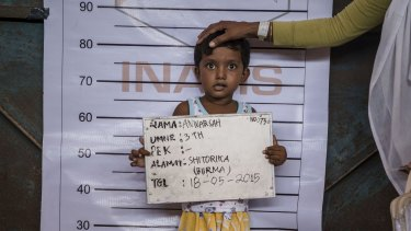 Three-year-old Anwarsah, a Rohingya child, poses for an identification photo at a temporary shelter in Aceh province, Indonesia, in May 2015.