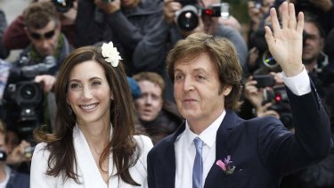 Getting hitched ... Paul McCartney and bride Nancy Shevell arrive for their marriage ceremony at Old Marylebone Town Hall in London.