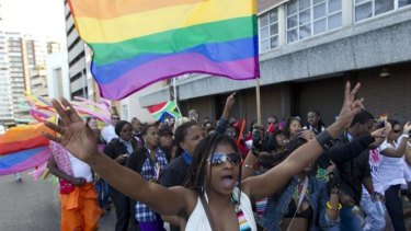 A woman holds her hands up during the Durban Pride parade where several hundred people marched through the Durban city centre back in 2011 in support of gay rights.