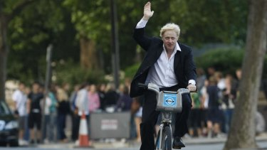 No Spandex required ... London Mayor Boris Johnson on a share bicycle.