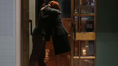 Julia Gillard is hugged by an attendant as she leaves the House of Representatives on Thursday 27 June.