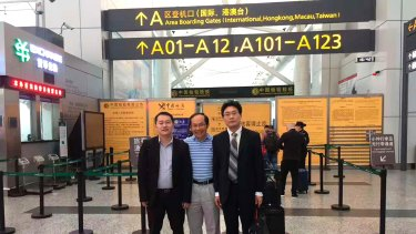 Professor Feng at the Guangzhou Airport on Saturday afternoon with his lawyers Chen Jingxue (at left) and Liu Hao (at right).