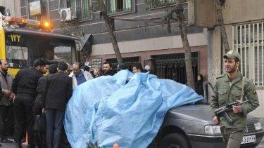 The scene of the bomb blast in Tehran that killed Iranian nuclear scientist Mostafa Roshan.