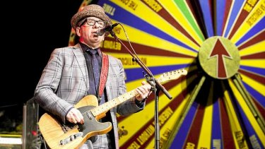 "Spin king: Elvis Costello and the Imposters, backed up by the ""Spectacular Spinning Songbook""."