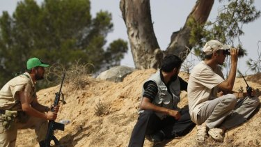 Fighters keep watch for pro-Gaddafi forces on the outskirts of Zlitan.