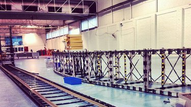 This 50,000-piece bridge lays waiting for this weekend's record attempt to build the World's Longest Working Lego Bridge in a Layout.
