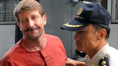 Viktor Bout is escorted into a Bangkok court.